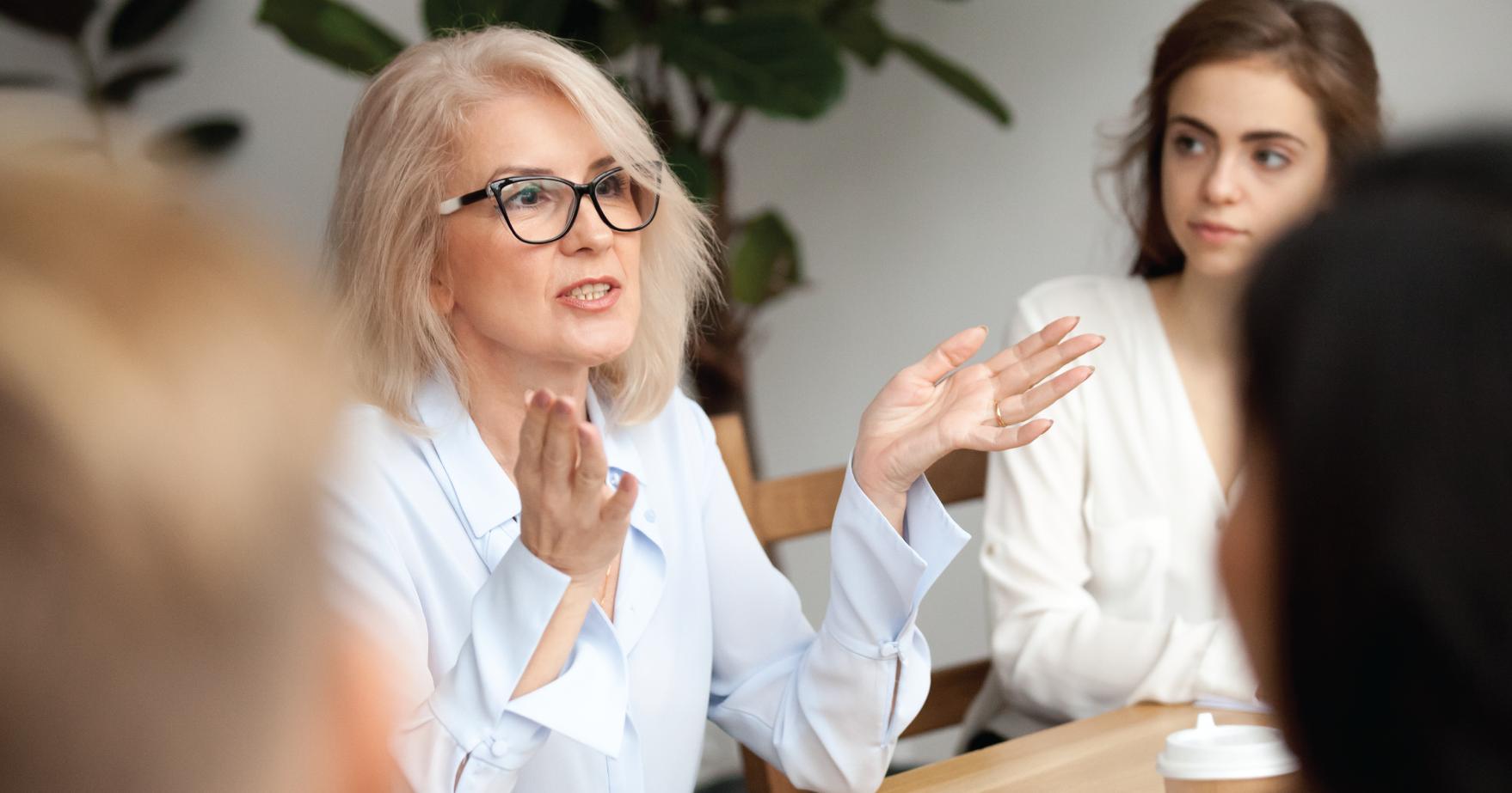 Women Speaking in A Meeting