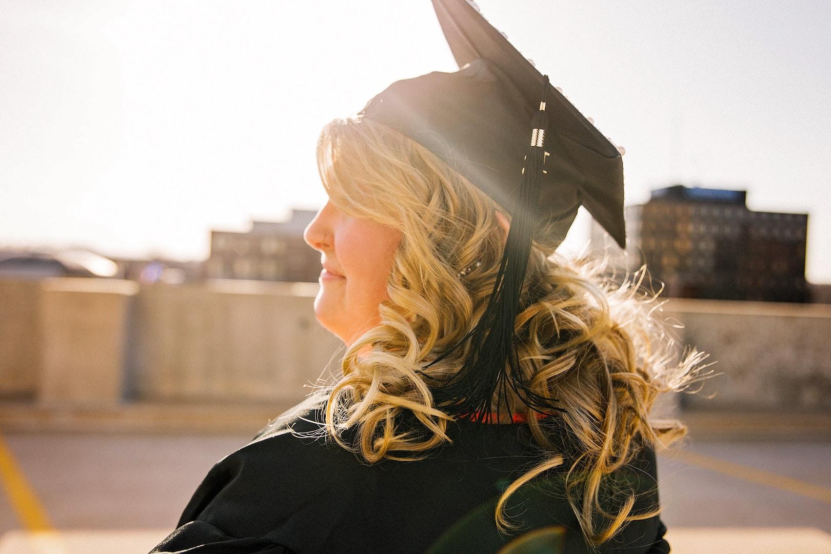 graduate-cap-sun-blonde-woman